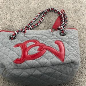 Betsyville gray flannel with red accents handbag.